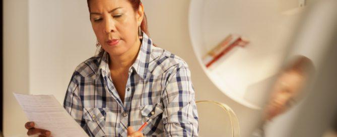 Woman reviewing her inheritances after divorce.